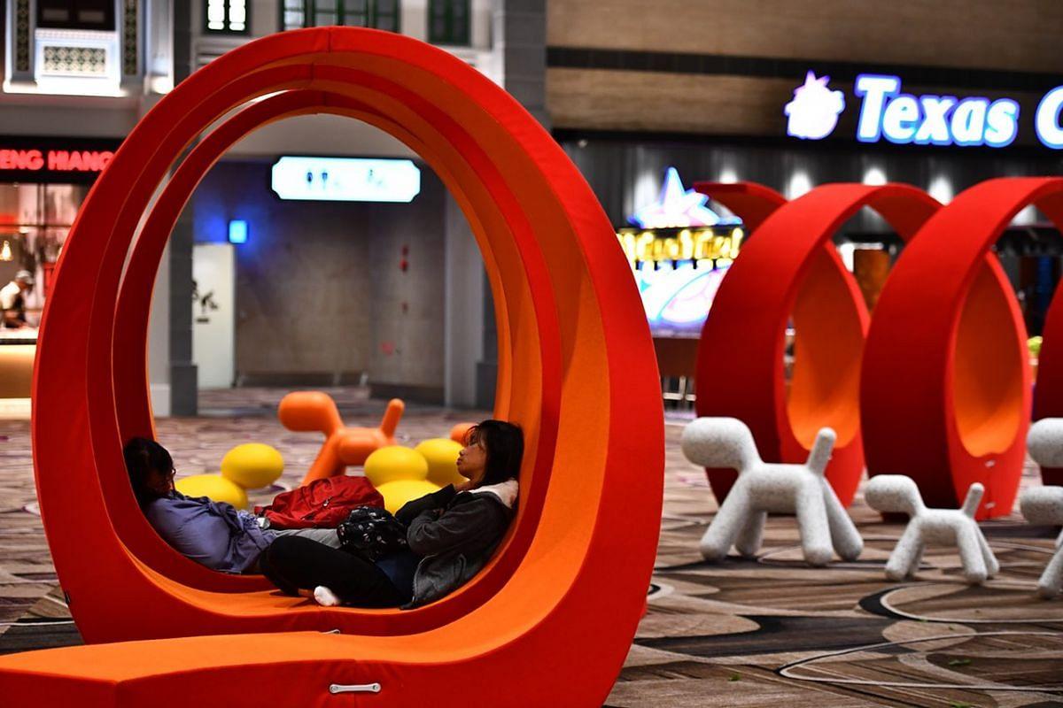 Passengers taking a break inside the departure transit area.