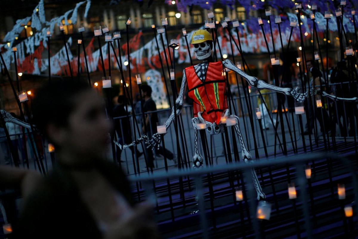 An altar displays a paper skeleton representing a rescue worker as part for the upcoming annual Day of the Dead on November 1 and 2, at the Zocalo in Mexico City, Mexico, October 30, 2017. PHOTO: REUTERS