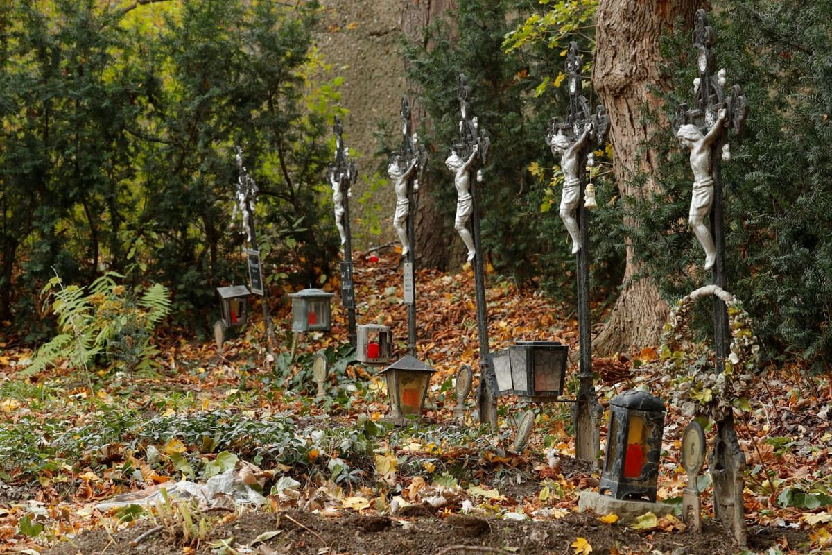 """Graves are lined up at the """"Friedhof der Namenlosen"""" (""""Cemetery of the Nameless"""") near the Albern harbour in Vienna, Austria, October 30, 2017. The cemetery, which was created for corpses that once washed up on the banks of the Danube, has lost its o"""