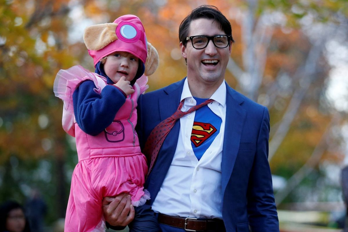 Canada's Prime Minister Justin Trudeau carries his son Hadrien while participating in Halloween festivities at Rideau Hall in Ottawa, Ontario, Canada, October 31, 2017. PHOTO: REUTERS