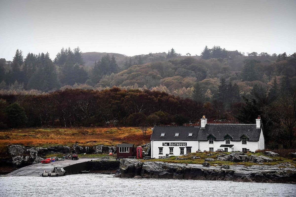 The boathouse cafe is seen across the water on the Isle of Ulva.