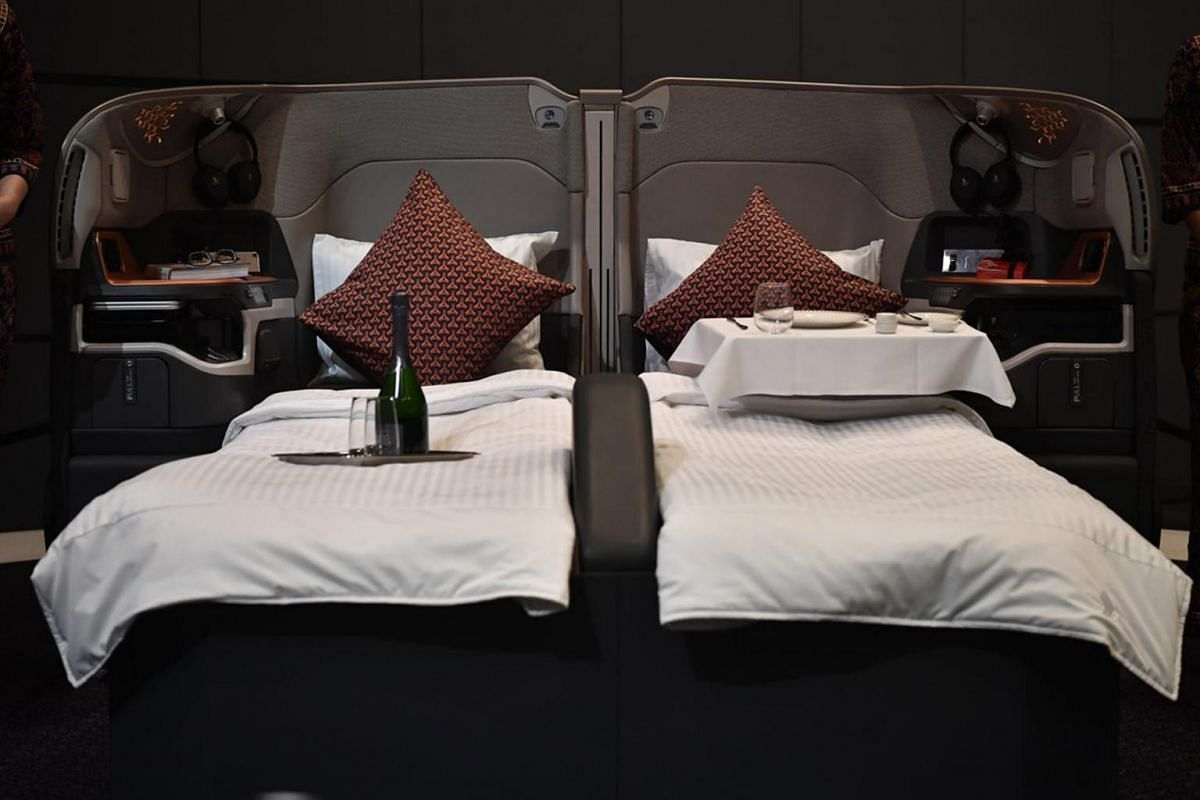 Business-class seats will include a full-length divider between centre seats which can be converted into couple seats.