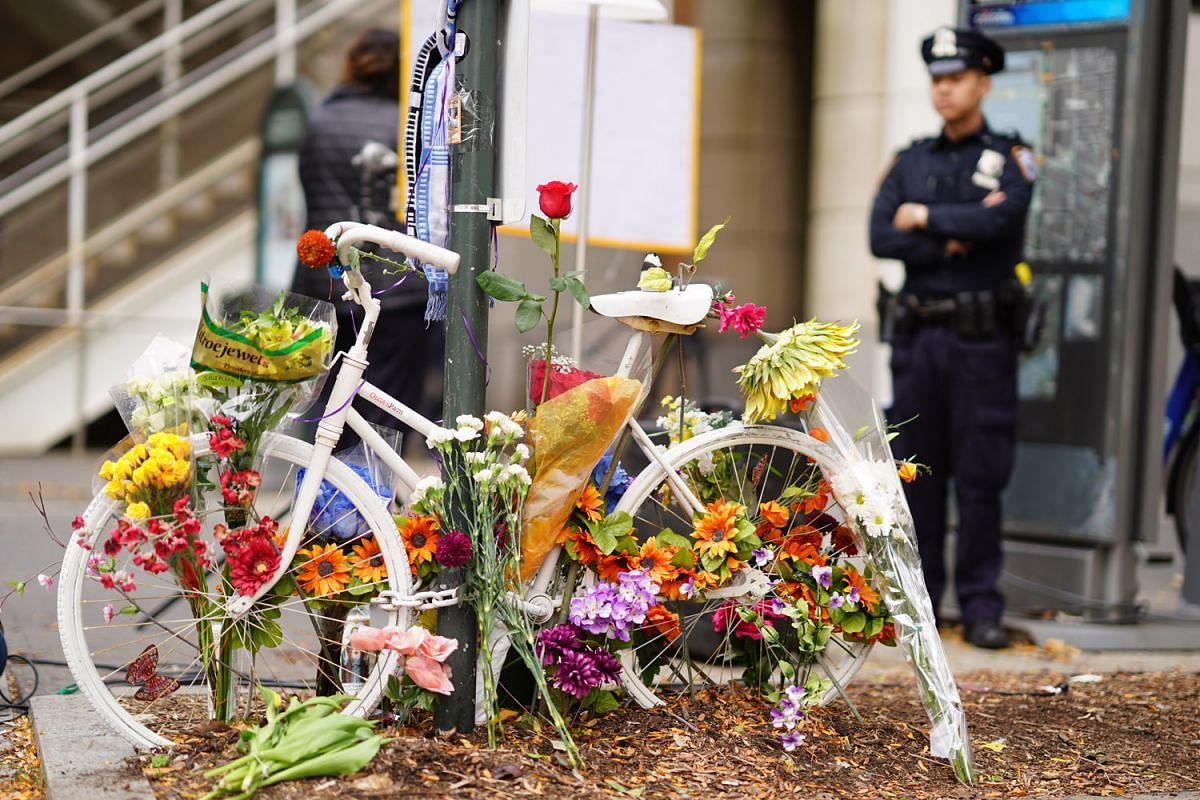 A decorated bike in memory of the victims of the terror attack near Stuyvesant High School in New York, Nov. 2, 2017. A truck attack on Tuesday ended in front of the high school. The driver plowed through a bicycle path for multiple blocks, killing e