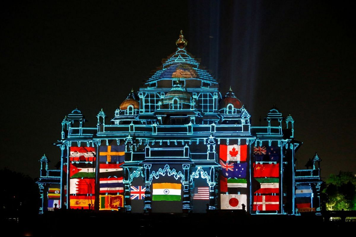 The Akshardham temple is illuminated during a laser light show to celebrate the temple's silver jubilee in Gandhinagar, India, November 2, 2017. PHOTO: REUTERS