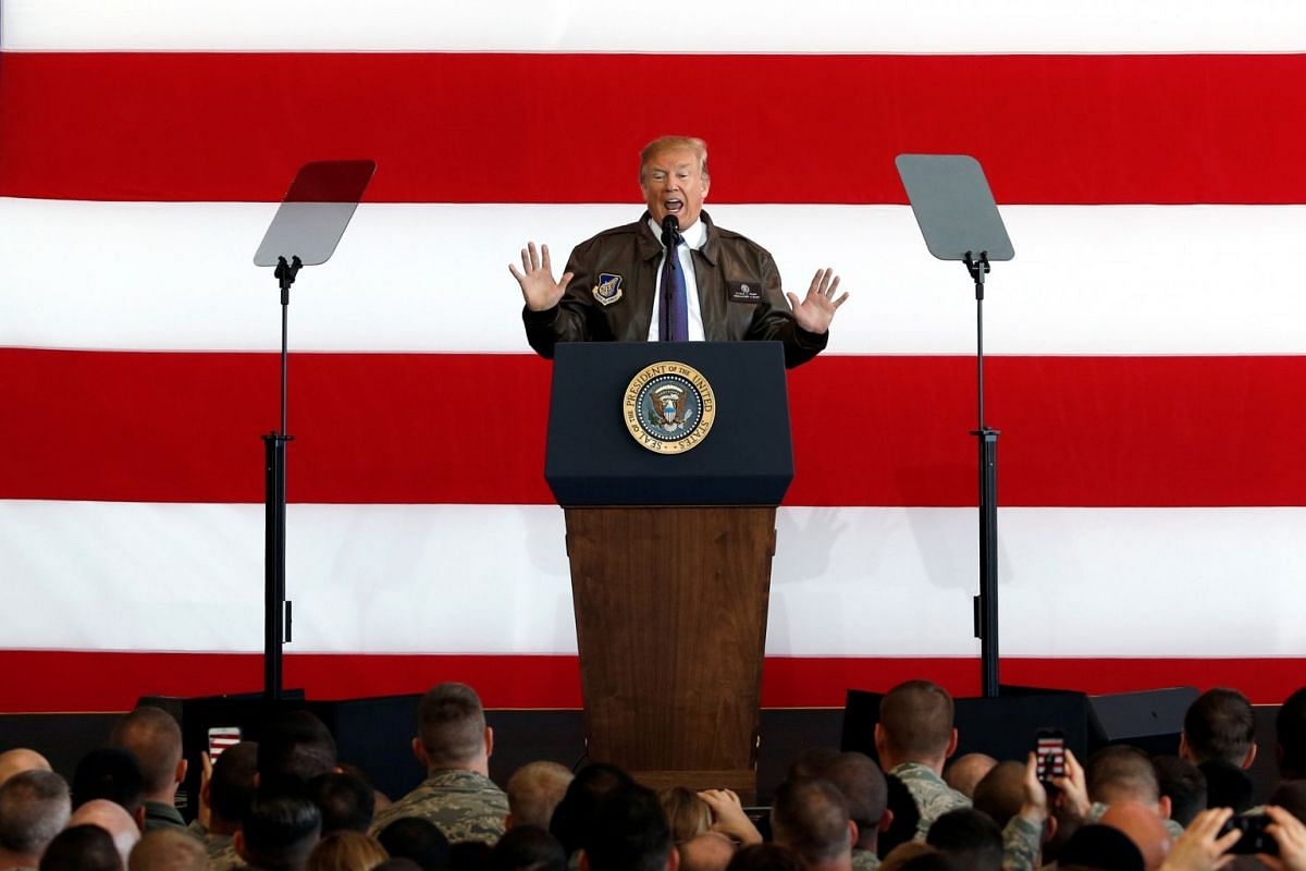 US President Donald Trump addresses members of US military services and Japan Self-Defense Force (JSDF) at the US Air Force Yokota base in Fussa, Tokyo on Nov 5, 2017.