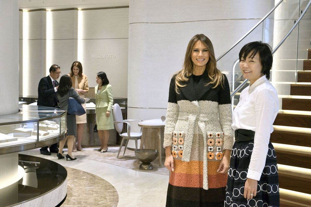 US first lady Melania Trump and Akie Abe, wife of Japan's Prime Minister Shinzo Abe, pose for photo at Mikimoto Pearl head shop in Tokyo's Ginza district, Japan, on Nov 5, 2017.