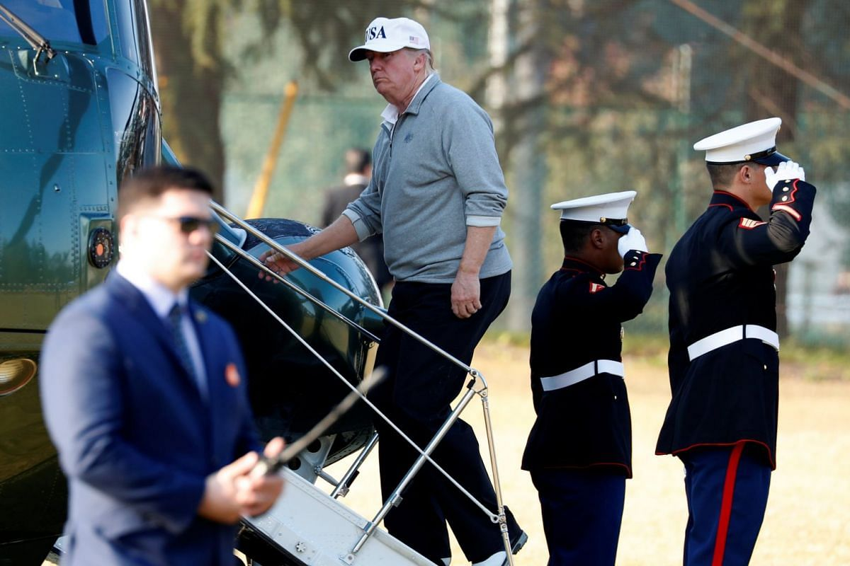 US President Donald Trump departs after a round of golf with Japan's Prime Minister Shinzo Abe at the Kasumigaseki Country Club in Kawagoe, Japan, on Nov 5, 2017.