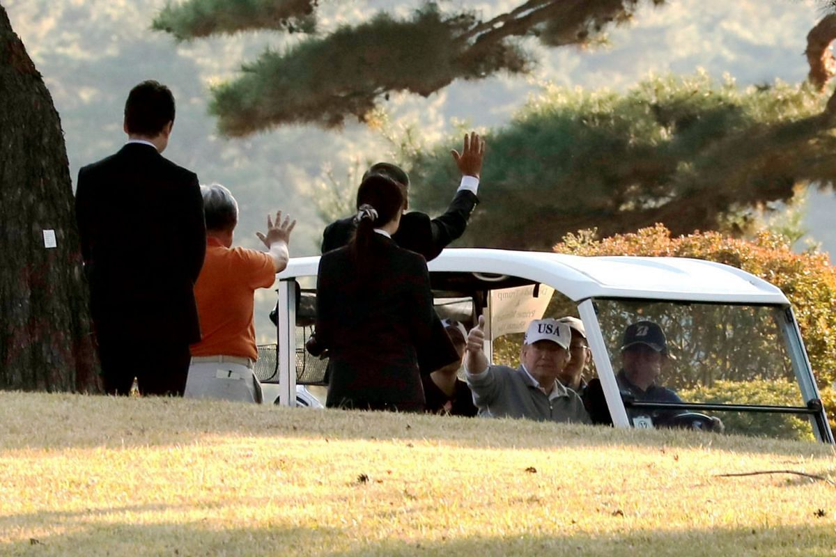 US President Donald Trump and Japan's Prime Minister Shinzo Abe along the cart path as they play a round of golf at the Kasumigaseki Country Club in Kawagoe, Japan, on Nov 5, 2017.