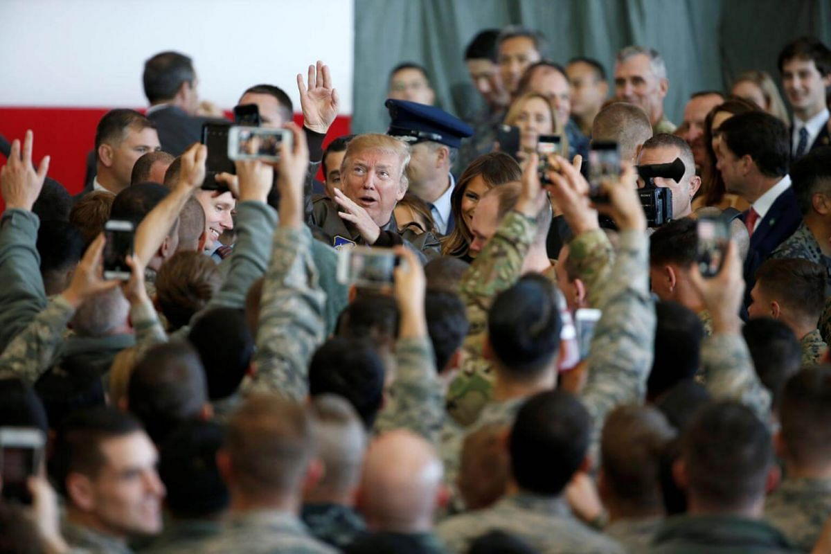US President Donald Trump gestures as he speaks with members of US military services and Japan Self-Defense Force (JSDF) at the US Air Force Yokota base in Fussa, Tokyo on Nov 5, 2017.