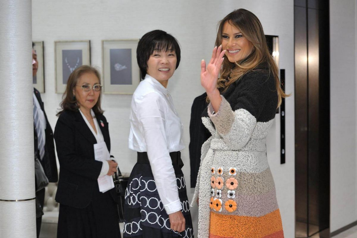 US First Lady Melania Trump (right) is welcomed by Japanese First Lady Akie Abe upon arriving at Mikimoto Ginza Main Store in the fashionable Ginza district of Tokyo on Nov 5, 2017.