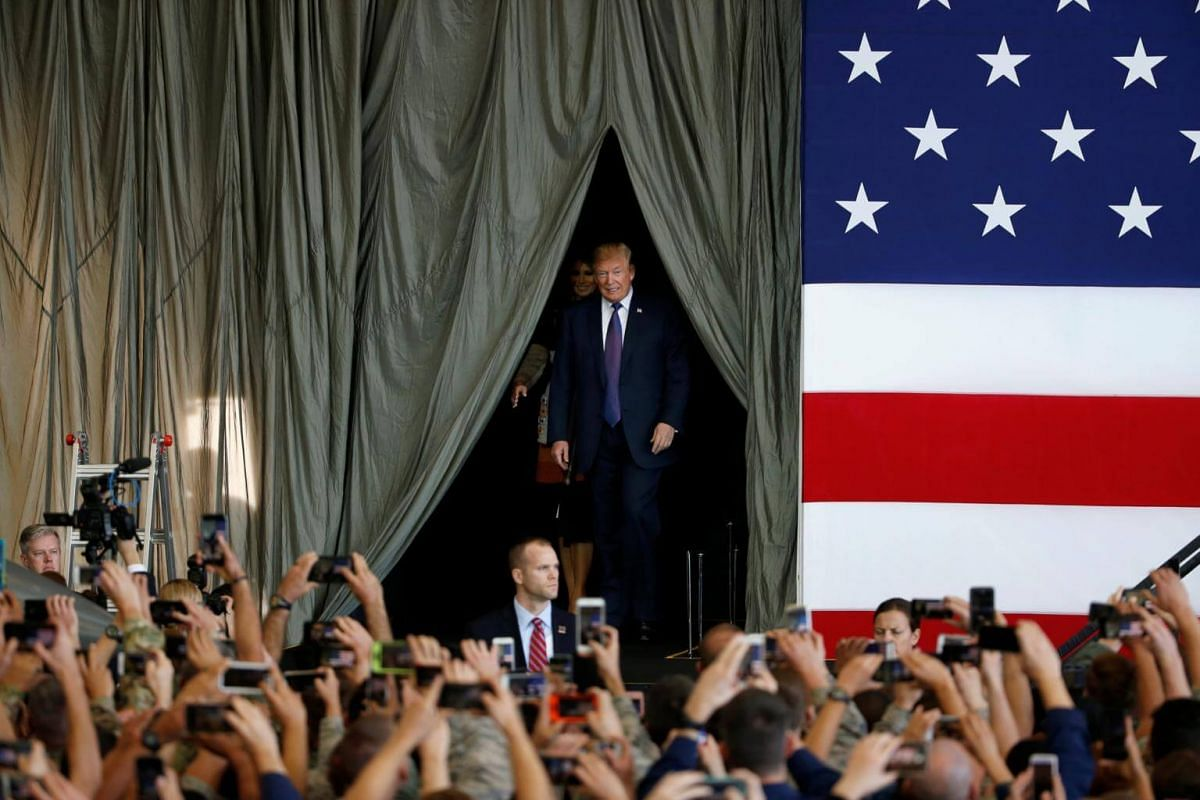 US President Donald Trump preparing to deliver a speech at the US Air Force Yokota base in Fussa, Tokyo on Nov 5, 2017.