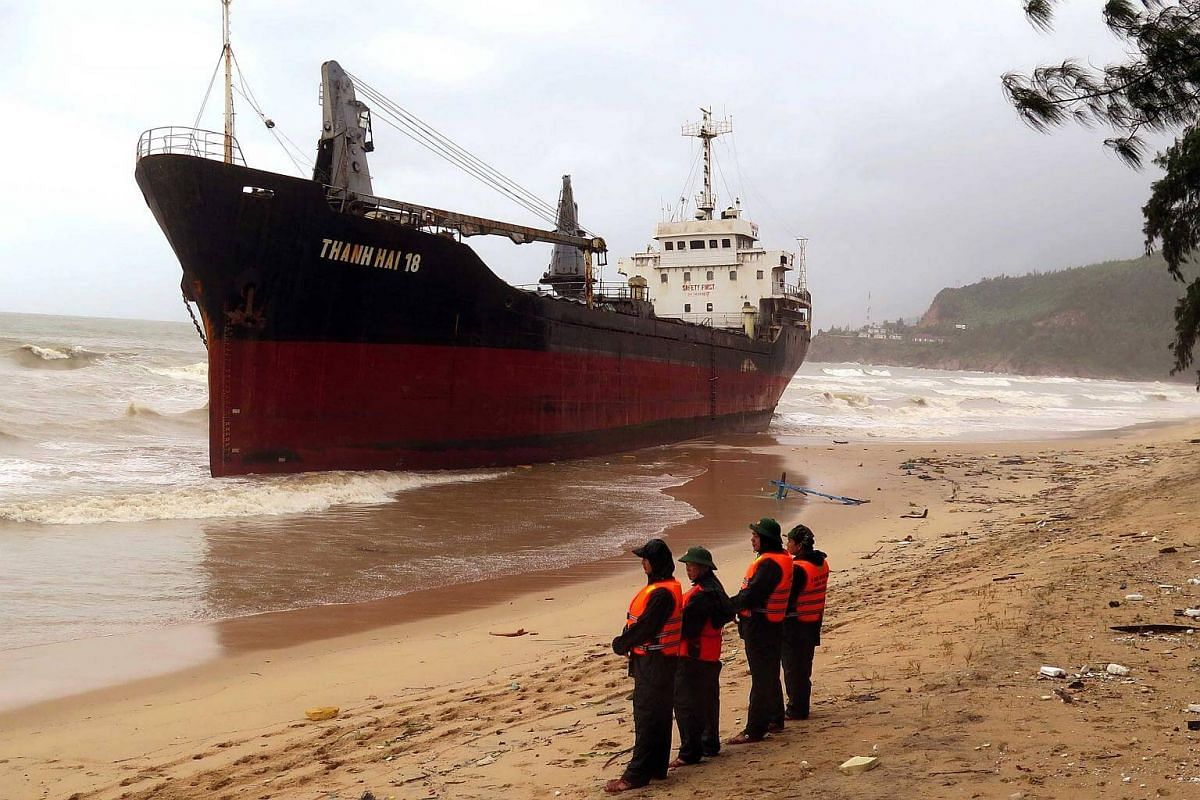 A ship pushed ashore in the central province of Binh Dinh after Typhoon Damrey made landfall in central Vietnam.