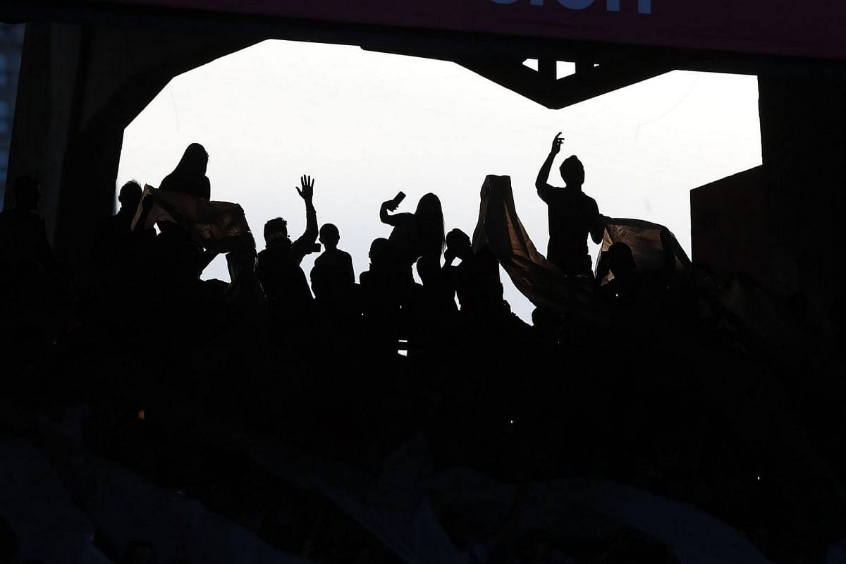River Plate's fans support their team during a soccer match held at the Monumental stadium in Buenos Aires, Argentina.