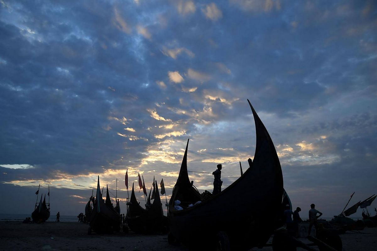 Bangladeshi fishermen get ready as they prepare to venture in the sea for fishing at the Shaplapur beach in Shaplapur.