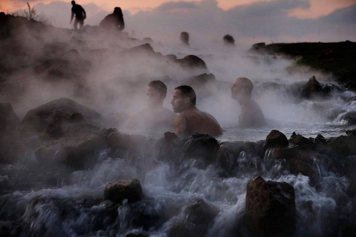 Israelis take a dip in a hot water pool in the northern part of in the Israeli-occupied Golan Heights.
