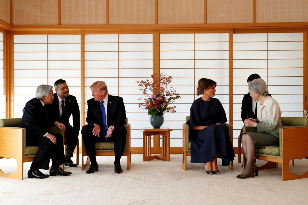 US President Donald Trump (third from left) talks with Japan's Emperor Akihito (left) while his wife Melania (fourth from left) talks with Empress Michiko (right) at the Imperial Palace in Tokyo, Japan on Nov 6, 2017.