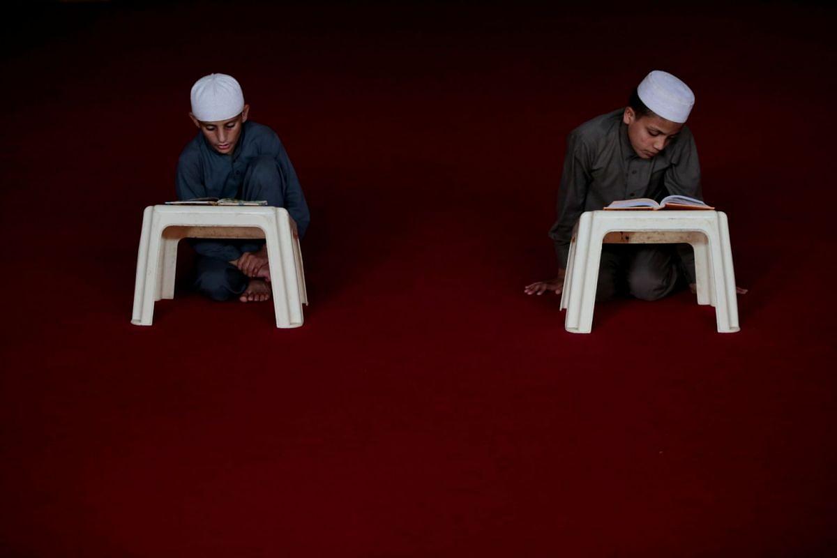 Students memorise the Koran at the Al-Nadwa Madrassa in Murree, Pakistan, October 3, 2017.