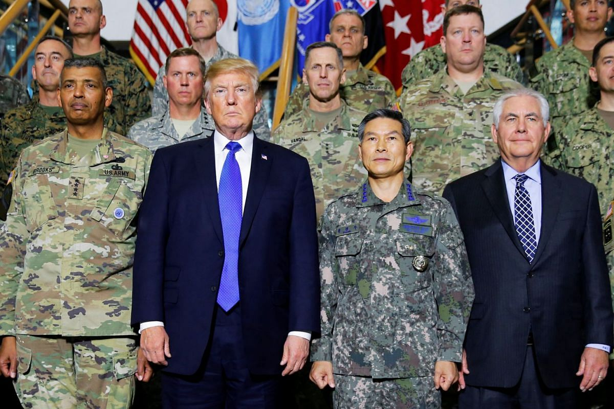 US President Donald Trump poses for a photo with military commanders at the US Eighth Army Operation Command Center at the US military installation Camp Humphreys in Pyeongtaek, South Korea, on Nov 7, 2017.