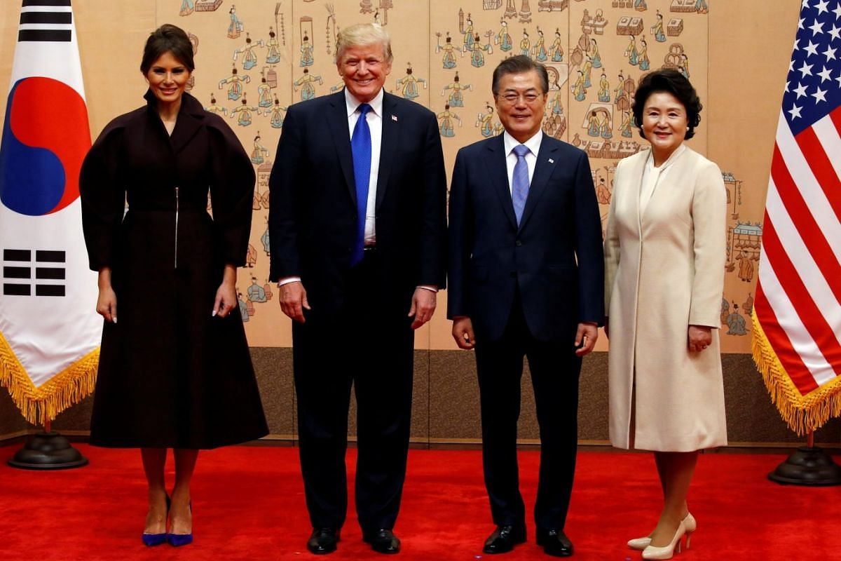 US President Donald Trump, US First Lady Melania, South Korea's President Moon Jae In and South Korea's First Lady Kim Jung Sook pose for a photo at the presidential Blue House in Seoul on Nov 7, 2017.