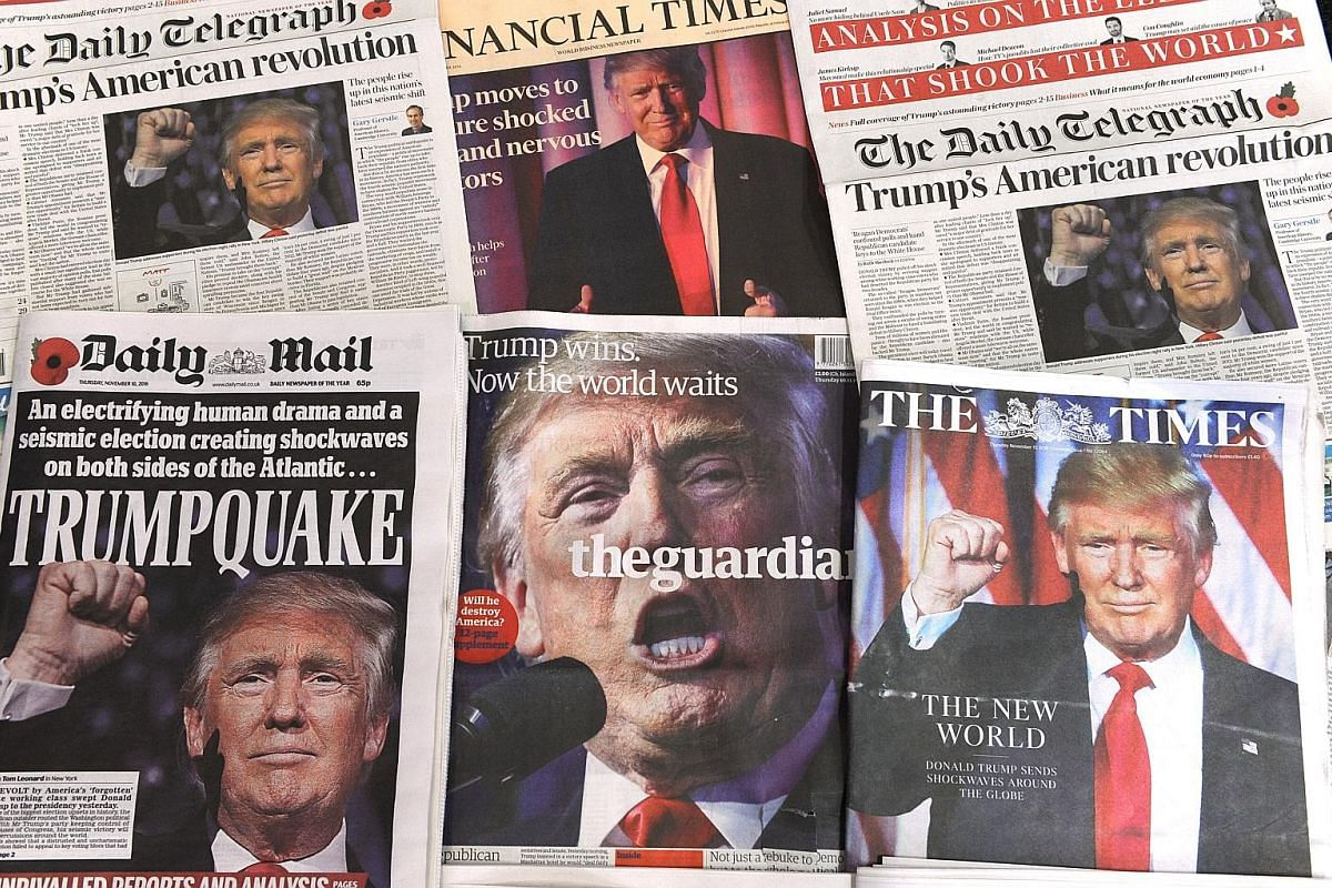 Above: A selection of front pages of British newspapers showing the global reaction to Mr Donald Trump's shock US presidential victory on Nov 10 last year. Top: Then President-elect Donald Trump on stage with his family, celebrating his winning the U