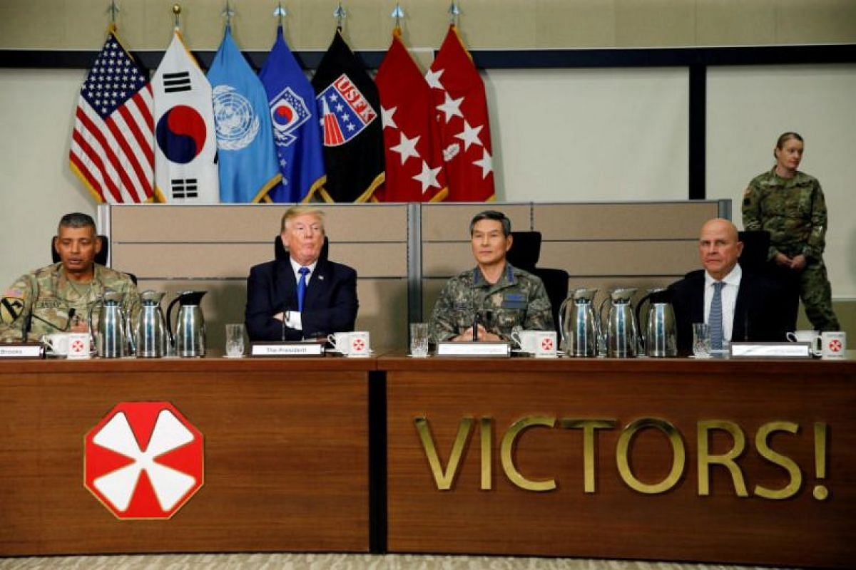 US President Donald Trump receives a briefing from military commanders at the US Eighth Army Operation Command Centre at US Camp Humphreys in Pyeongtaek, South Korea, on Nov 7, 2017. PHOTO: REUTERS