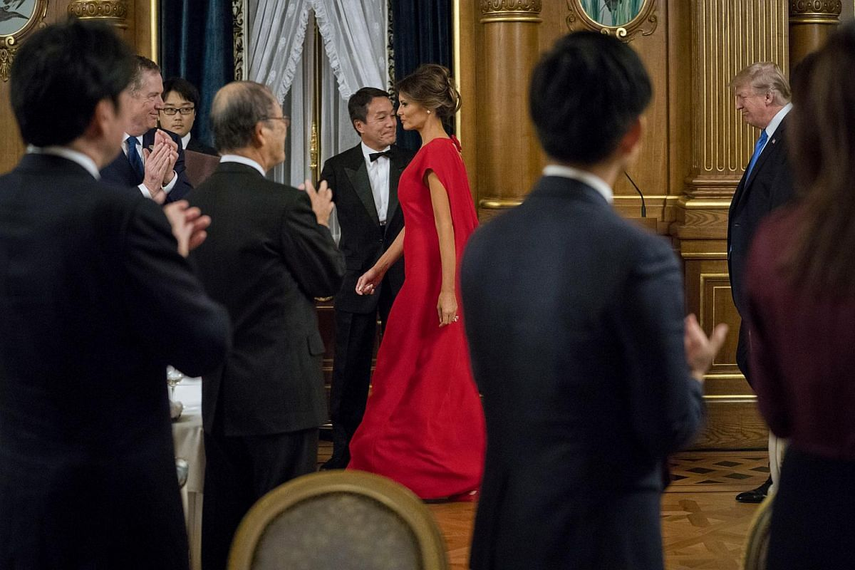 First lady Melania Trump and President Donald Trump are applauded as they arrive to a state banquet with PM Abe, at Akasaka Palace.