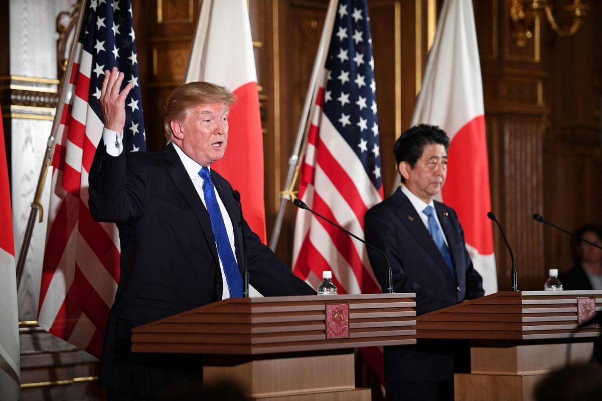 US President Trump and Japan's PM Shinzo Abe (right) attend a press conference at Akasaka Palace.