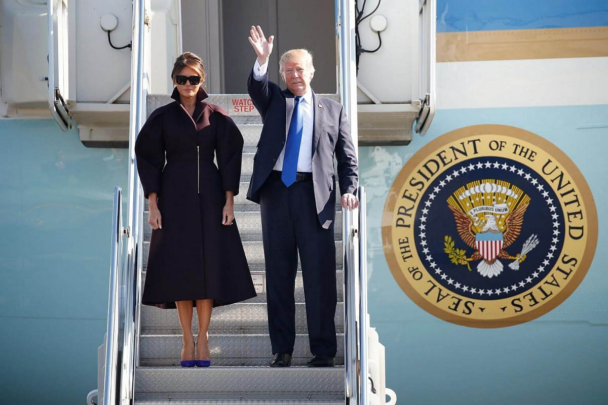 US President Donald Trump and first lady Melania board Air Force One as they depart for Seoul, from US Air Force Yokota base in Fussa, Japan.