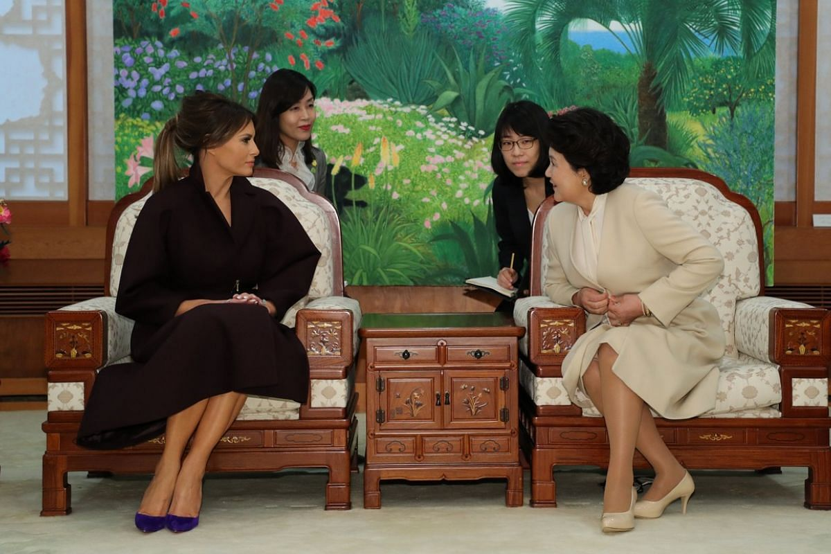 South Korean First Lady Kim Jung Sook talks with US First Lady Melania Trump during their meeting at the presidential Blue House in Seoul on Nov 7, 2017.