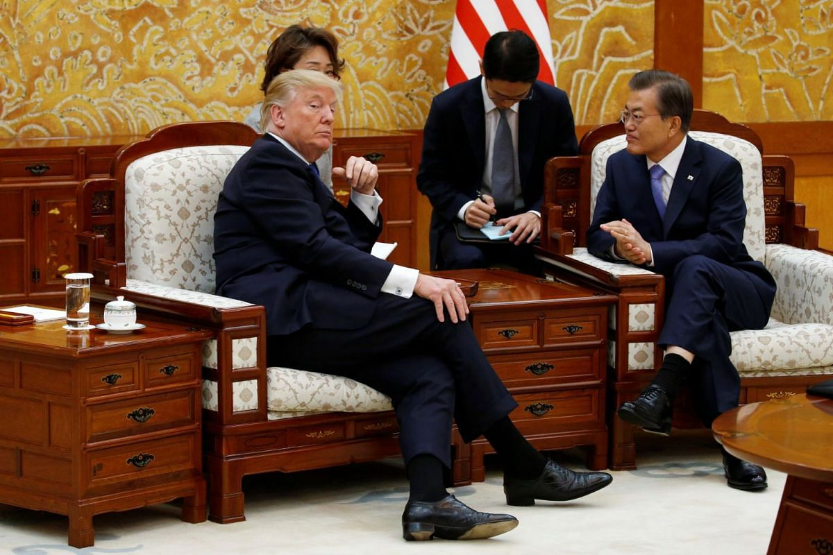 US President Donald Trump and South Korea's President Moon Jae In hold a bilateral meeting at the presidential Blue House in Seoul on Nov 7, 2017.