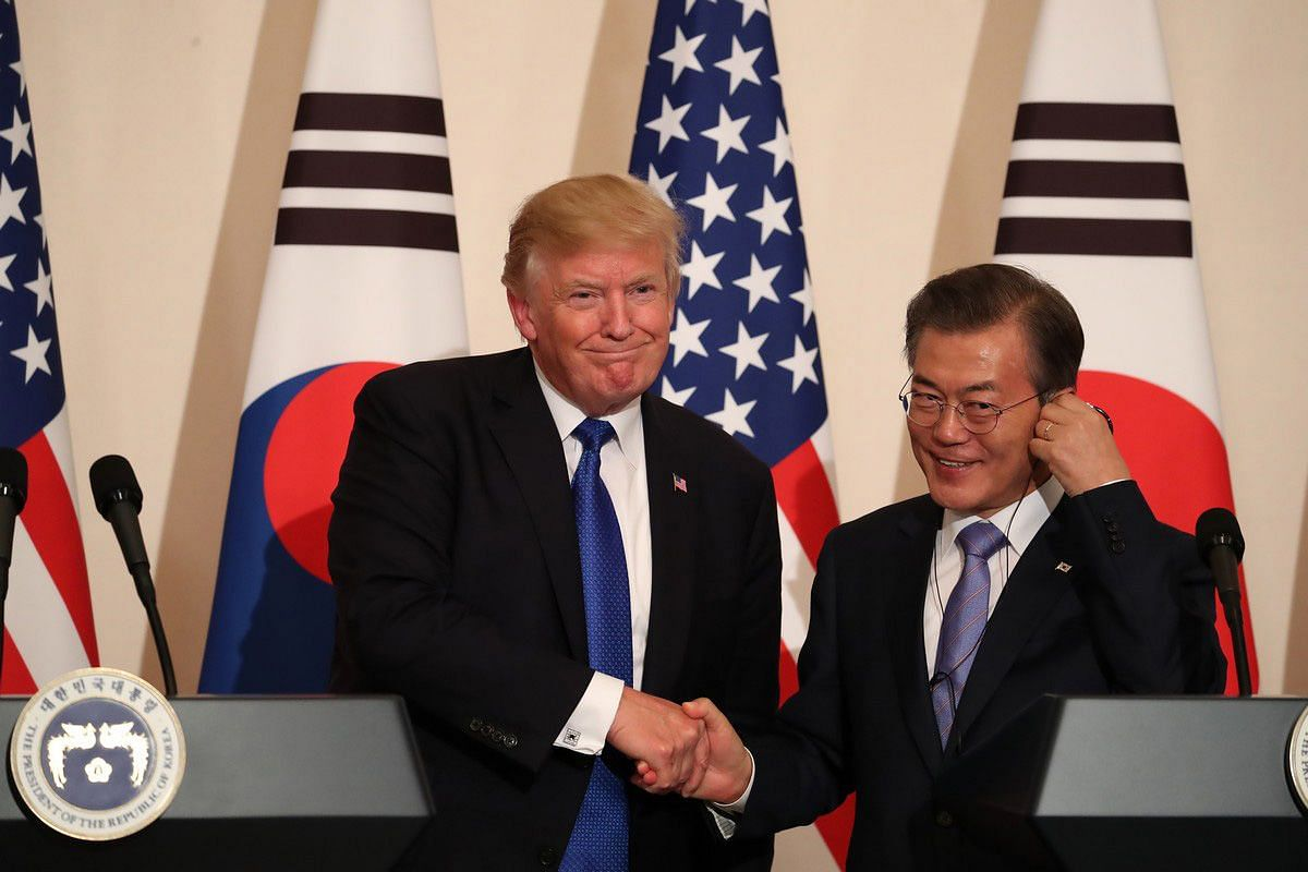 US President Donald Trump shakes hands with South Korea's President Moon Jae In during a news conference at the presidential Blue House in Seoul on Nov 7, 2017.