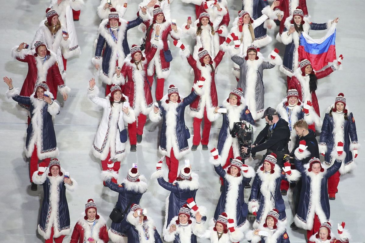 Russian athletes at the opening ceremony of the 2014 Sochi Olympic Games. Top Olympic leaders are said to be considering barring Russia's flag and anthem from the 2018 Winter Olympics in response to its doping violations in Sochi.
