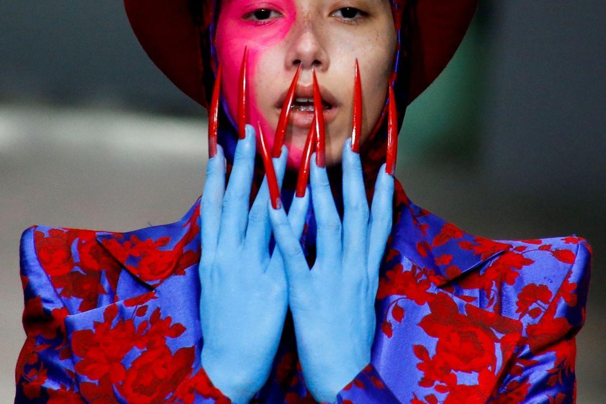 A model presents a creation by Hu Sheguang at China Fashion Week in Beijing, China November 7, 2017