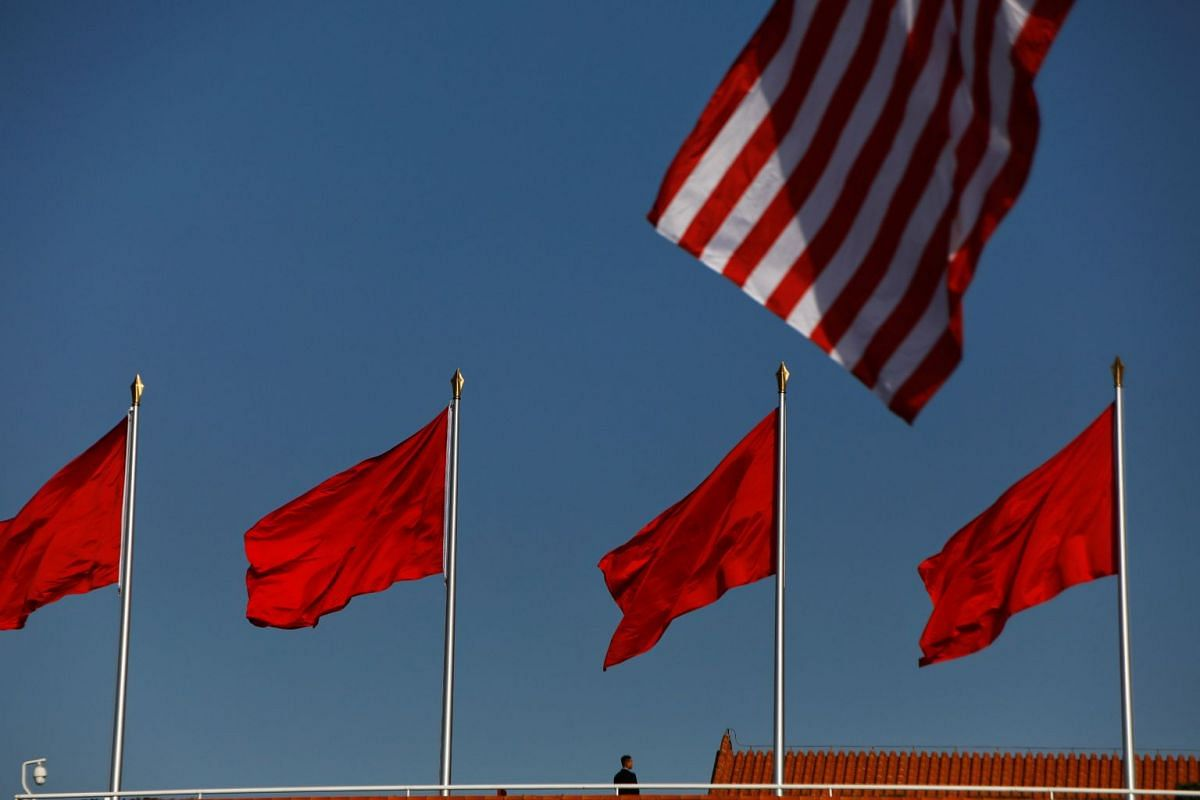 A security agent takes his position as U.S. and China's flags flutter over the Forbidden City ahead of the visit by U.S. President Donald Trump to Beijing, China November 8, 2017.