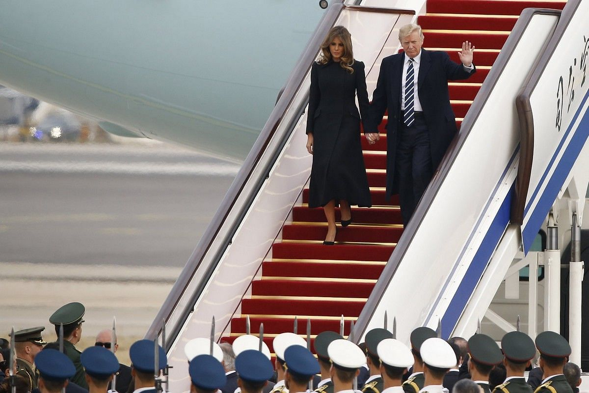 US President Donald Trump and First Lady Melania arrive on Air Force One in Beijing on Nov 8, 2017.