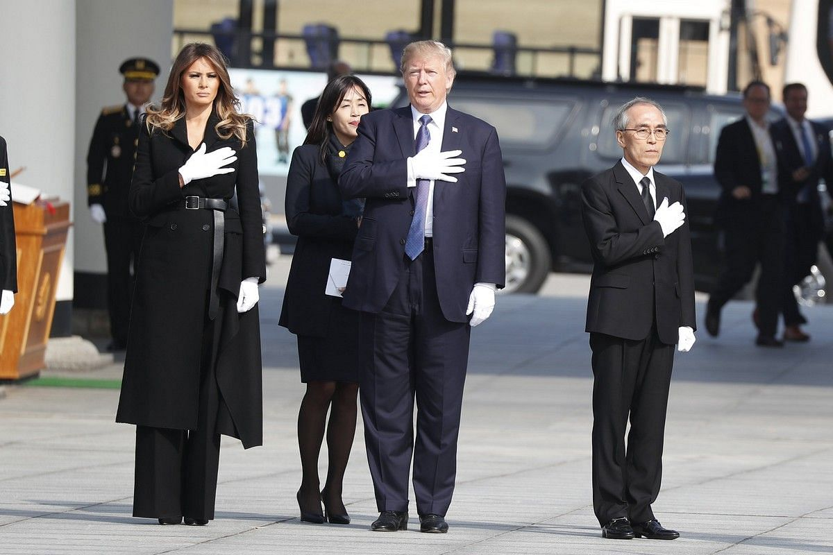 US President Donald Trump and First Lady Melania salute during their visit to the National Cemetery in Seoul on Nov 8, 2017.