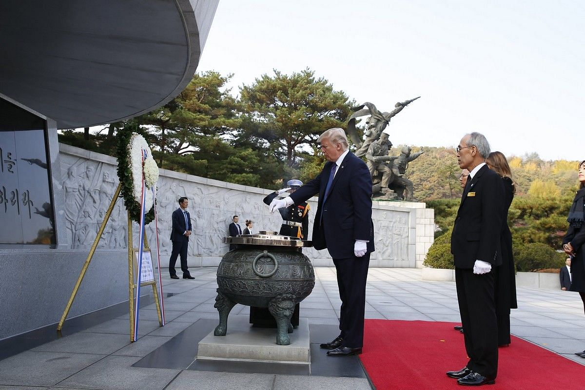 US President Donald Trump burns incense during his visit to the National Cemetery in Seoul on Nov 8, 2017.