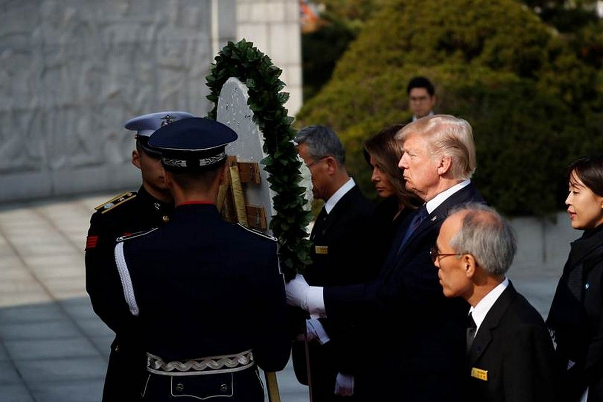 US President Donald Trump and First Lady Melania prepare to lay a wreath at the National Cemetery in Seoul on Nov 8, 2017.