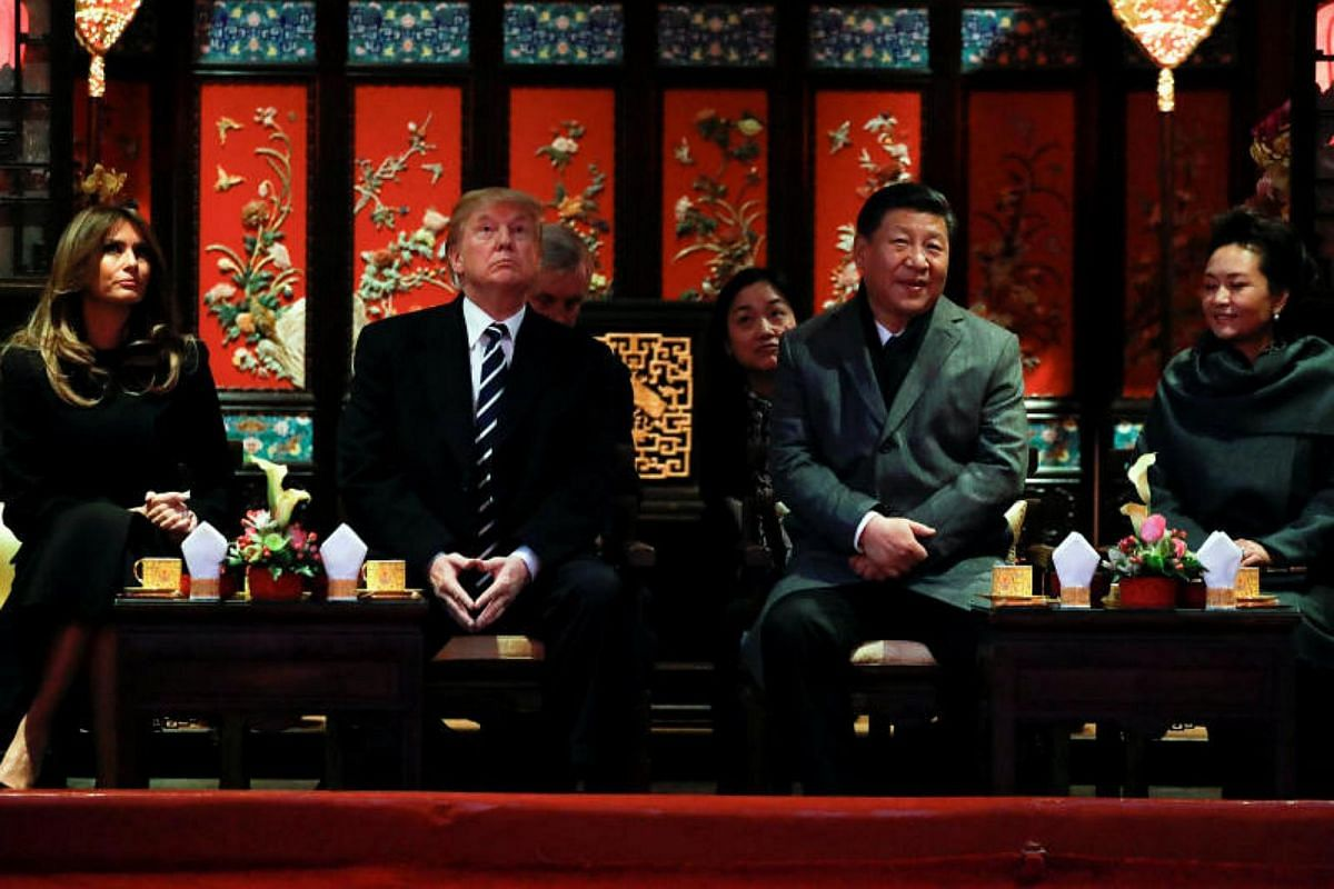 US President Donald Trump, first lady Melania and China's President Xi Jinping pose with opera performers at the Forbidden City in Beijing, China, Nov 8, 2017.