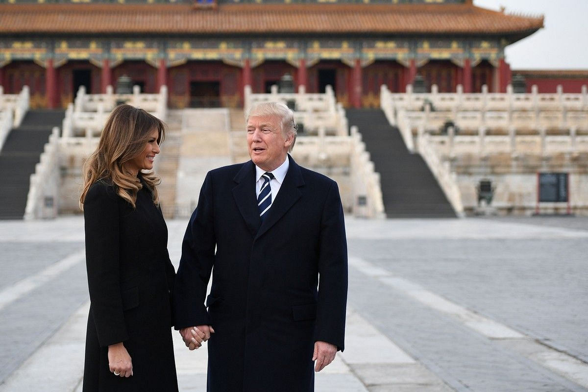 US President Donald Trump holds hands with First Lady Melania in the Forbidden City in Beijing on Nov 8, 2017.