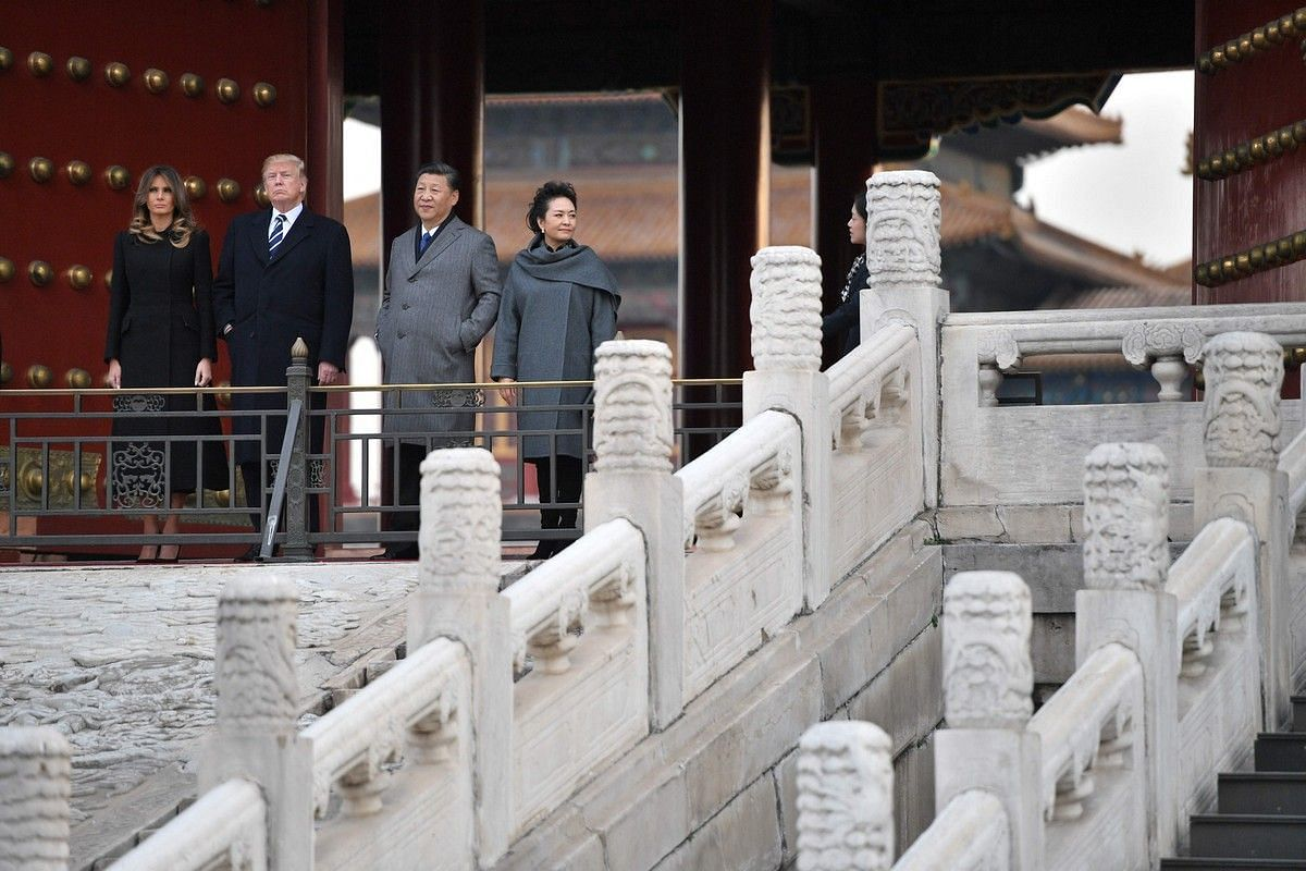 US President Donald Trump, US First Lady Melania Trump, China's President Xi Jinping and his wife Peng Liyuan tour the Forbidden City in Beijing on Nov 8, 2017.