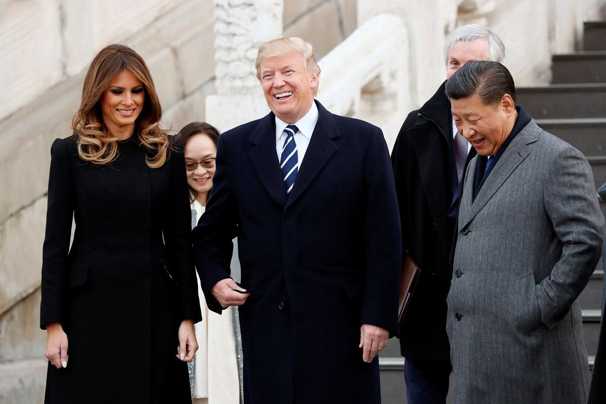US President Donald Trump, US First Lady Melania and China's President Xi Jinping share a laugh while touring the Forbidden City in Beijing on Nov 8, 2017.