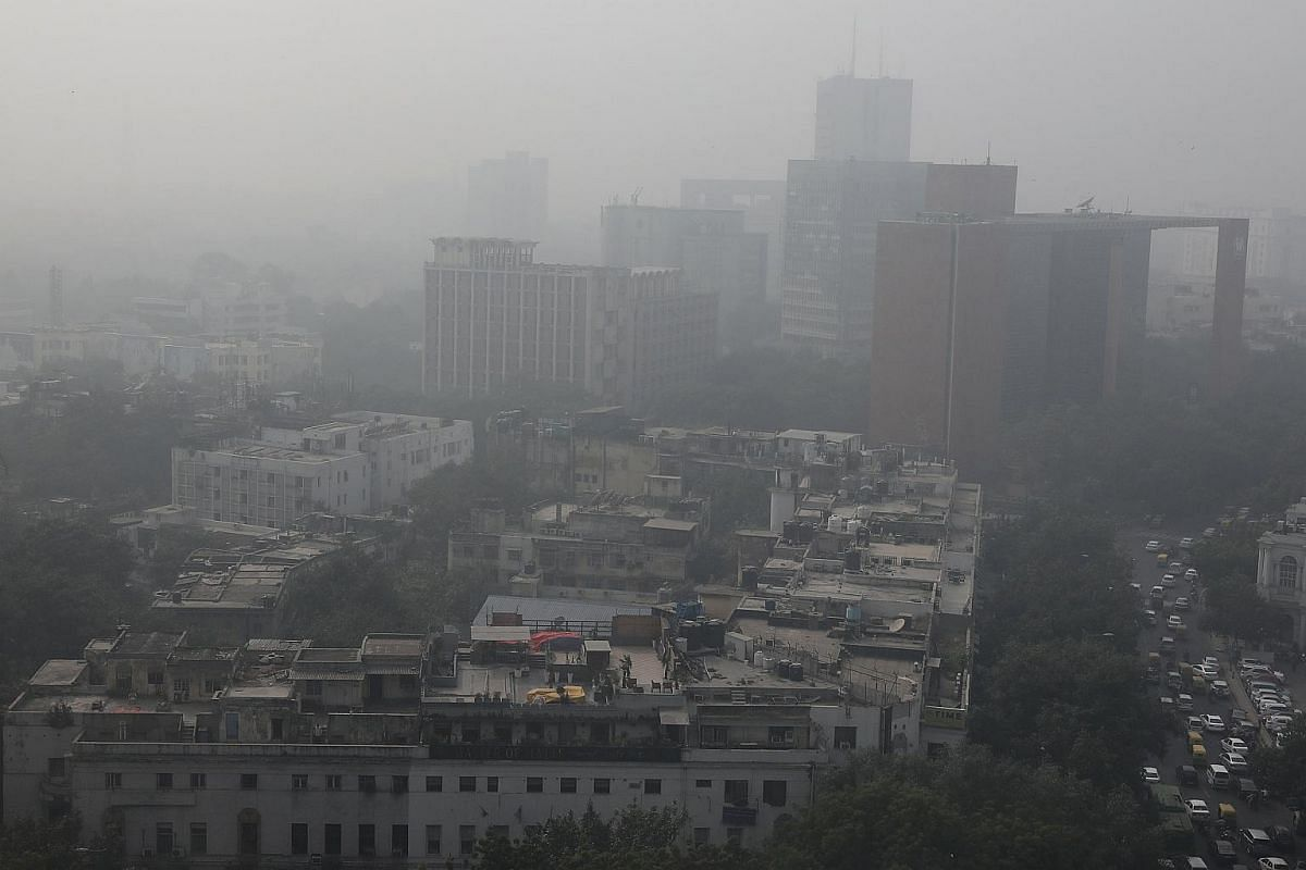 An aerial view shows buildings engulfed in smog, in New Delhi.