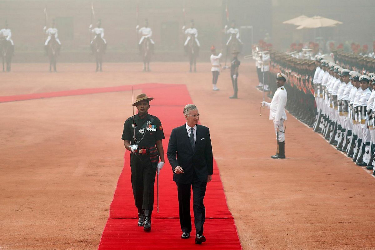 Belgium's King Philippe inspects a guard of honour during his ceremonial reception at India's presidential palace, in New Delhi.