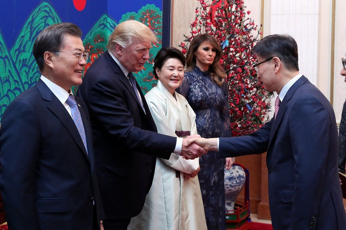 US President Donald Trump shakes hands with Yoon Boo Keun, vice-chairman of Samsung Electronics Co, during a state dinner at the presidential Blue House in Seoul on Nov 7, 2017.