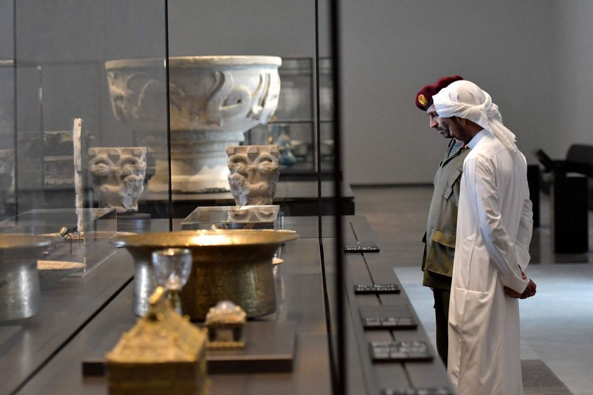 Security guards looking at statues on display at the Louvre Abu Dhabi Museum on Nov 6, 2017 ahead of the museum's official opening.
