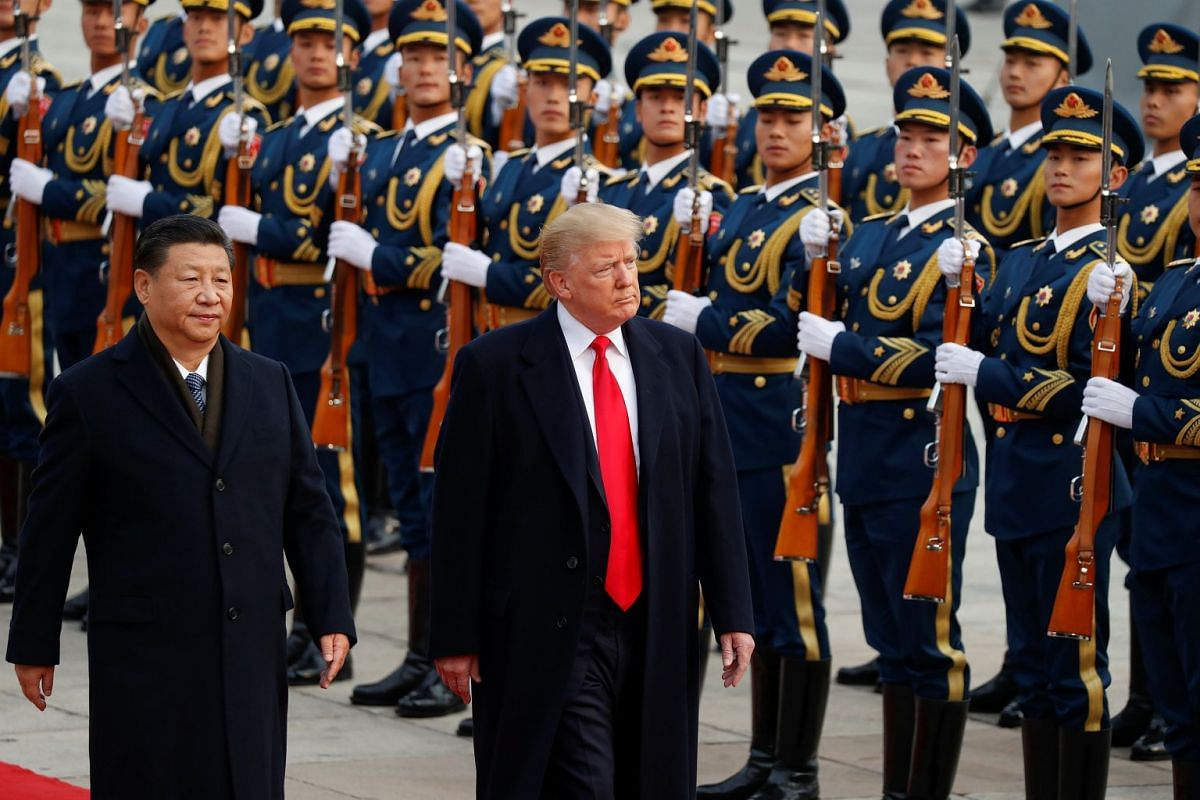 US President Donald Trump takes part in a welcoming ceremony with China's President Xi Jinping in Beijing, China, on Nov 9, 2017.