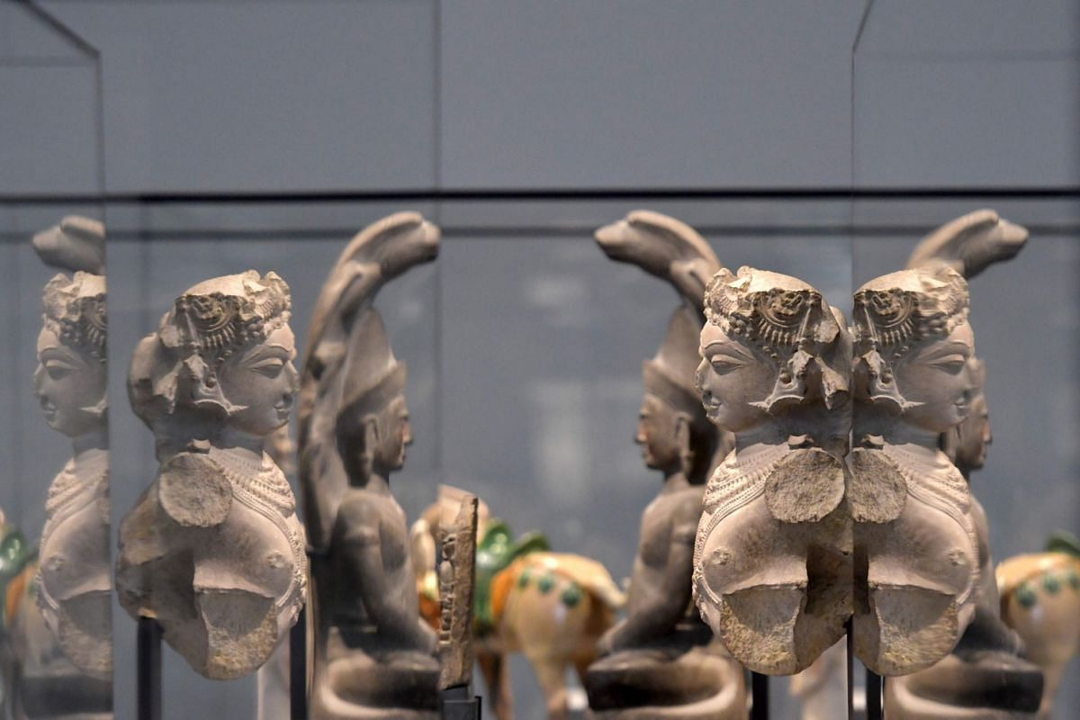 Statues displayed in a gallery at the Louvre Abu Dhabi Museum.