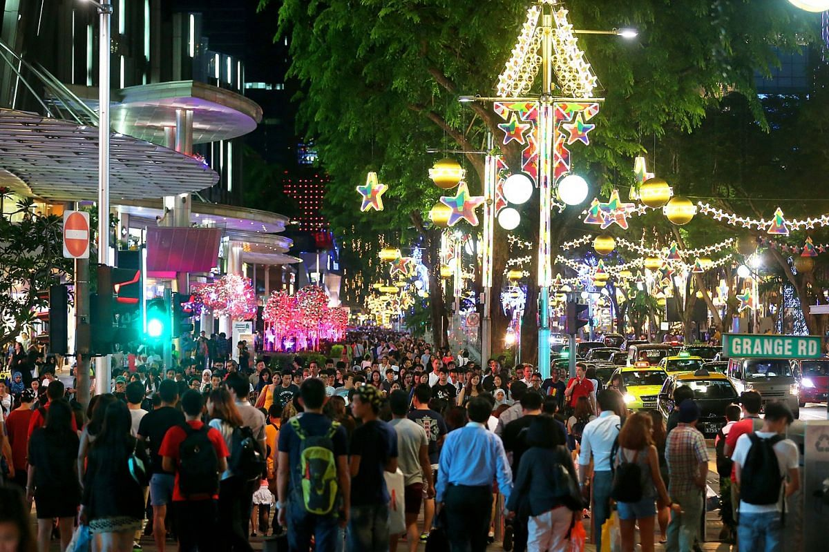 2014: Crowds thronged the length of Orchard Road, especially in front of Mandarin Gallery, during the Christmas light-up on Nov 15.