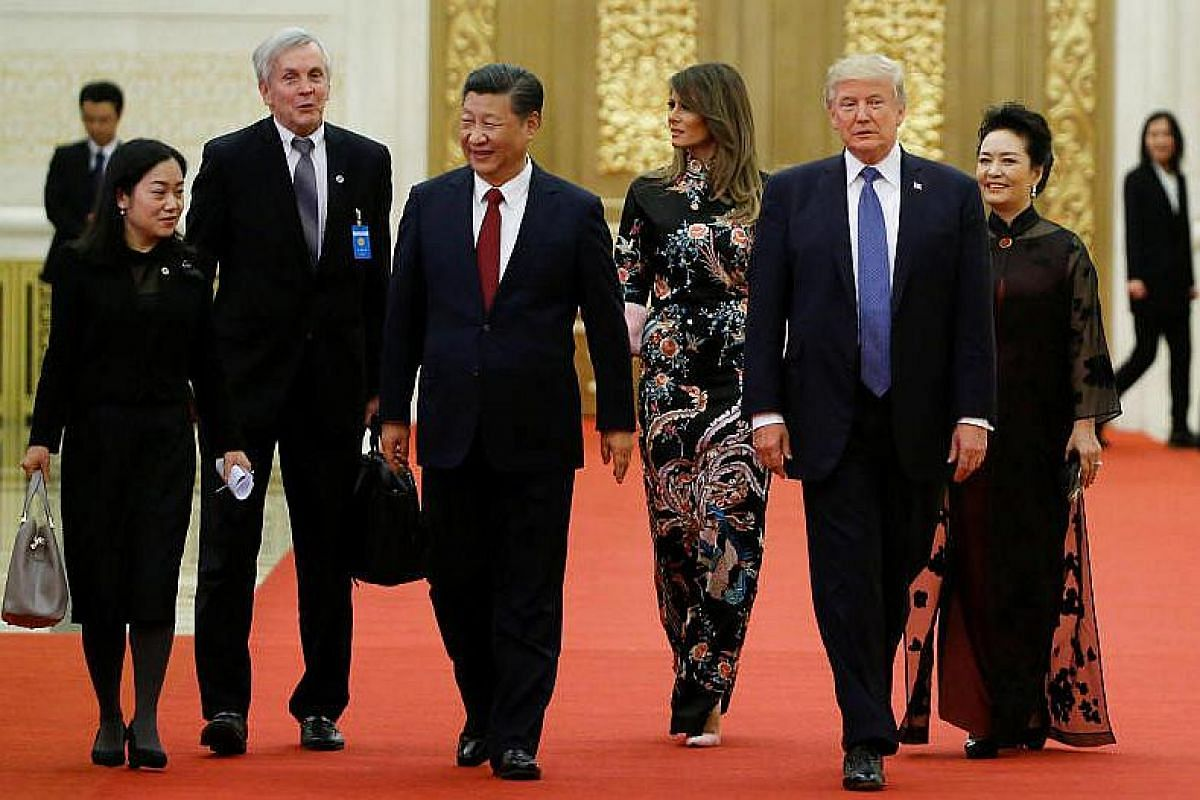 US President Donald Trump and first lady Melania arrive for the state dinner with China's President Xi Jinping and China's first lady Peng Liyuan at the Great Hall of the People in Beijing, China on Nov 9, 2017.